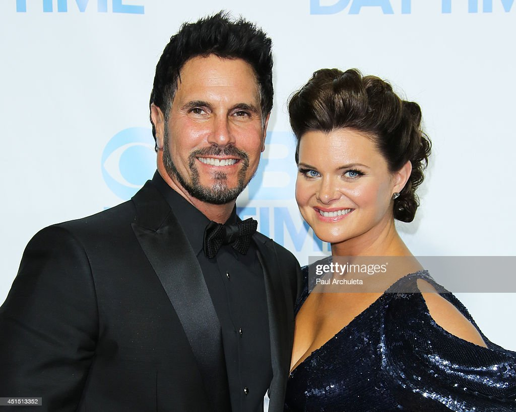 Actors <a gi-track='captionPersonalityLinkClicked' href=/galleries/search?phrase=Don+Diamont&family=editorial&specificpeople=606917 ng-click='$event.stopPropagation()'>Don Diamont</a> (L) and <a gi-track='captionPersonalityLinkClicked' href=/galleries/search?phrase=Heather+Tom&family=editorial&specificpeople=208780 ng-click='$event.stopPropagation()'>Heather Tom</a> (R) attend the 41st Annual Daytime Emmy Awards CBS after party at The Beverly Hilton Hotel on June 22, 2014 in Beverly Hills, California.