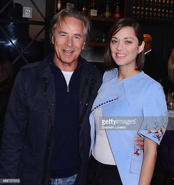 Actors Don Johnson and Marion Cotillard attend the 'Two Days One Night' premiere hosted by Sundance Selects with Dior Beauty and The Cinema Society...