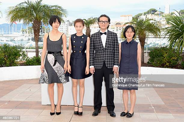 Actors Doona Bae Kim Sae Ron Song Sae Byuk and director July Jung attend the 'A Girl At My Door' photocall at the 67th Annual Cannes Film Festival on...