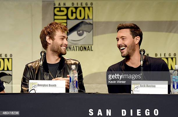 Actors Douglas Booth and Jack Huston speak onstage at the Screen Gems panel for 'Patient Zero' and 'Pride and Prejudice and Zombies' during ComicCon...