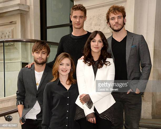 Actors Douglas Booth Holliday Grainger Max Irons Jessica Brown Findlay and Sam Claflin pose at a photocall for 'The Riot Club' at the Corinthia Hotel...
