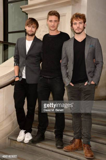 Actors Douglas Booth Max Irons and Sam Claflin pose at a photocall for 'The Riot Club' at the Corinthia Hotel in London on September 10 2014 in...