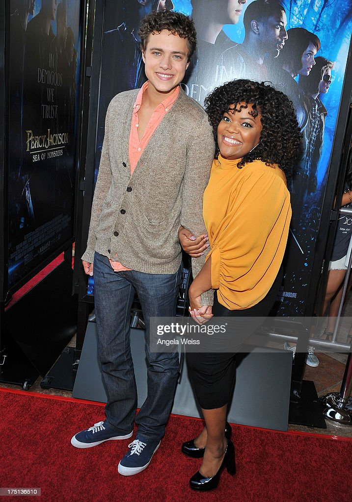 Actors Douglas Smith and <a gi-track='captionPersonalityLinkClicked' href=/galleries/search?phrase=Yvette+Nicole+Brown&family=editorial&specificpeople=4420097 ng-click='$event.stopPropagation()'>Yvette Nicole Brown</a> arrive at the premiere of 'Percy Jackson: Sea Of Monsters' at The Americana at Brand on July 31, 2013 in Glendale, California.