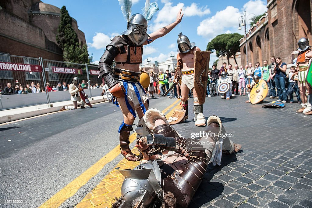 Actors dressed as ancient gladiators fight in a commemorative parade during festivities marking the 2,766th anniversary of the founding of Rome on April 21, 2013 in Rome, Italy. The capital celebrates its founding annually based on the legendary foundation of the Birth of Rome. Actors dressed as the denizens of ancient Rome participate in parades and re-enactments of the ancient Roman Empire. According to legend, Rome had been founded by Romulus in 753 BC in an area surrounded by seven hills.