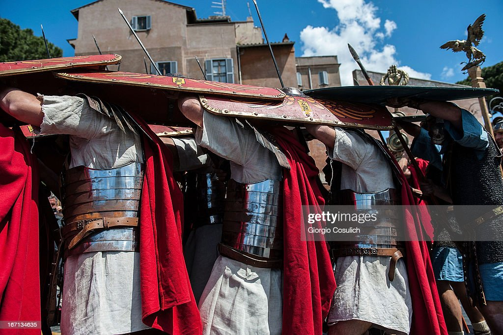 Actors dressed as ancient Roman soldiers cover themselves with shields as they march in a commemorative parade during festivities marking the 2,766th anniversary of the founding of Rome on April 21, 2013 in Rome, Italy. The capital celebrates its founding annually based on the legendary foundation of the Birth of Rome. Actors dressed as the denizens of ancient Rome participate in parades and re-enactments of the ancient Roman 753 BC in an area surrounded by seven hills.