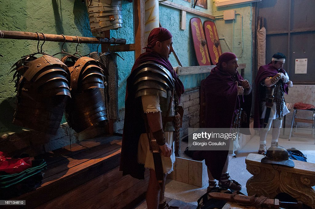 Actors dressed as ancient Roman soldiers dress up before to march in a commemorative parade during festivities marking the 2,766th anniversary of the founding of Rome on April 21, 2013 in Rome, Italy. The capital celebrates its founding annually based on the legendary foundation of the Birth of Rome. Actors dressed as the denizens of ancient Rome participate in parades and re-enactments of the ancient Roman Empire. According to legend, Rome had been founded by Romulus in 753 BC in an area surrounded by seven hills.