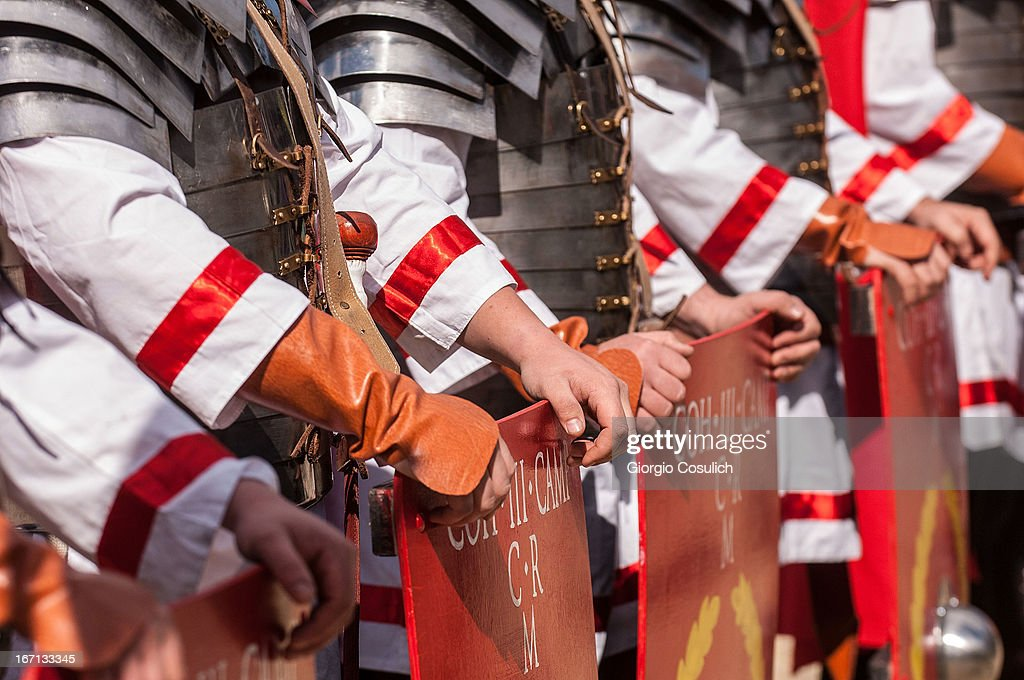 Actors dressed as ancient Roman soldiers hold shields as they get ready to march in a commemorative parade during festivities marking the 2,766th anniversary of the founding of Rome on April 21, 2013 in Rome, Italy. The capital celebrates its founding annually based on the legendary foundation of the Birth of Rome. Actors dressed as the denizens of ancient Rome participate in parades and re-enactments of the ancient Roman 753 BC in an area surrounded by seven hills.