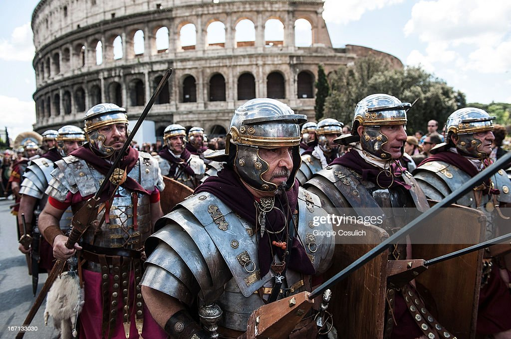 Actors dressed as ancient Roman soldiers march in front of the Coliseum in a commemorative parade during festivities marking the 2,766th anniversary of the founding of Rome on April 21, 2013 in Rome, Italy. The capital celebrates its founding annually based on the legendary foundation of the Birth of Rome. Actors dressed as the denizens of ancient Rome participate in parades and re-enactments of the ancient Roman Empire. According to legend, Rome had been founded by Romulus in 753 BC in an area surrounded by seven hills.