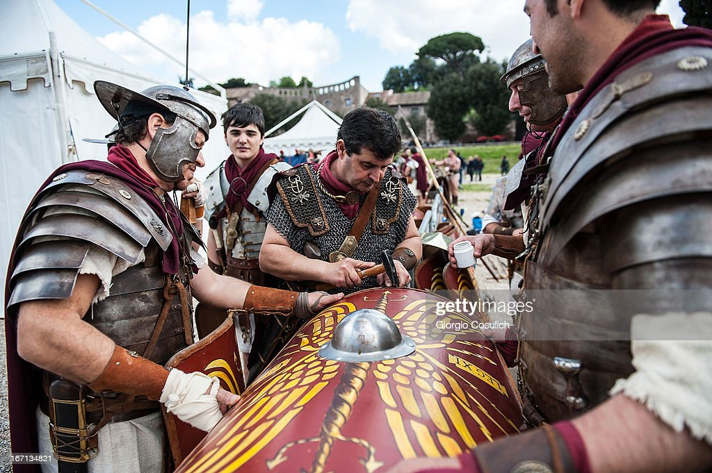 Actors dressed as ancient Roman soldiers repair a shield before to march in a commemorative parade during festivities marking the 2,766th anniversary of the founding of Rome on April 21, 2013 in Rome, Italy. The capital celebrates its founding annually based on the legendary foundation of the Birth of Rome. Actors dressed as the denizens of ancient Rome participate in parades and re-enactments of the ancient Roman 753 BC in an area surrounded by seven hills.
