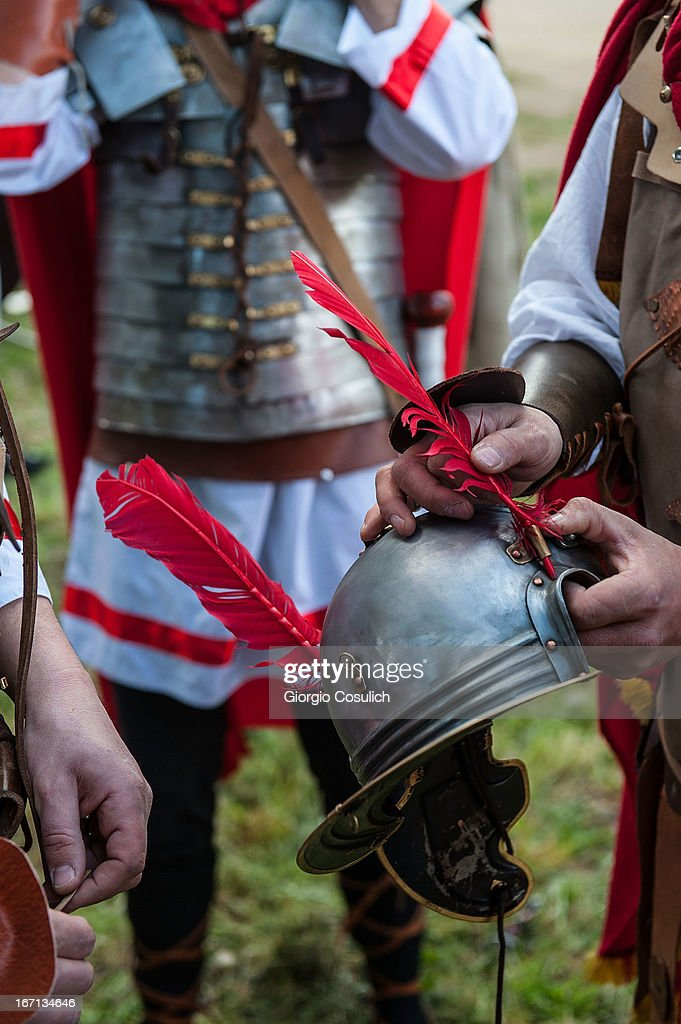 Actors dressed as ancient Roman soldiers repair an helmet before to march in a commemorative parade during festivities marking the 2,766th anniversary of the founding of Rome on April 21, 2013 in Rome, Italy. The capital celebrates its founding annually based on the legendary foundation of the Birth of Rome. Actors dressed as the denizens of ancient Rome participate in parades and re-enactments of the ancient Roman 753 BC in an area surrounded by seven hills.