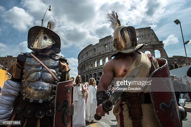Actors dressed as ancient Roman soldiers stand near the Coliseum as they attend a parade to commemorate the 2768th anniversary of the founding of...