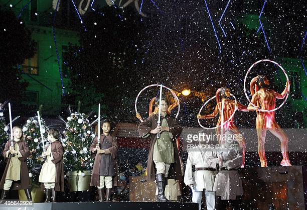 Actors dressed as characters from the Star Wars movie perform during the launch of the Christmas illuminations at the Galeries Lafayette shopping...