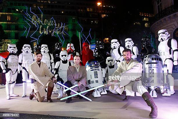 Actors dressed as characters from the Star Wars movie 'Star Wars Episode VII The Force Awakens' pose with Sphero BB8 Star Wars droids during the...