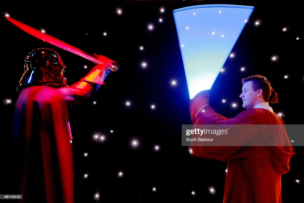 Actors dressed as Darth Vader and Luke Skywalker have a lightsaber battle during a preview to the 'Star Wars Where Science Meets Imagination'...