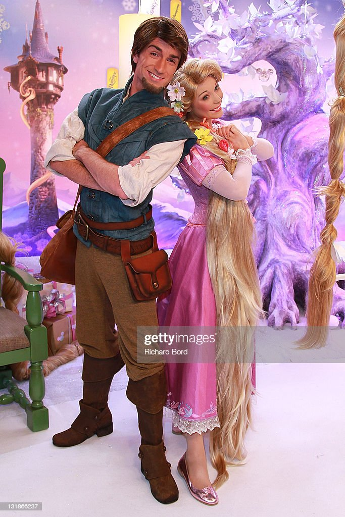 Actors dressed as Flynn and Raiponce attend the Raiponce Premiere during the Christmas Season Launch at Disneyland Paris on November 6 2010 in Paris...