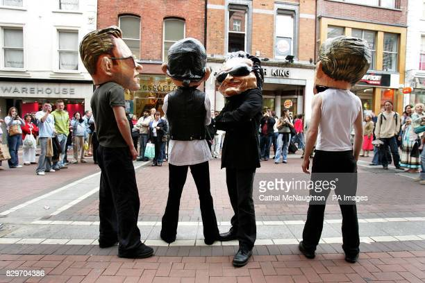 Actors dressed as Irish supergroup U2 perform ahead of the first of their three Vertigo tour sellout gigs at Croke Park