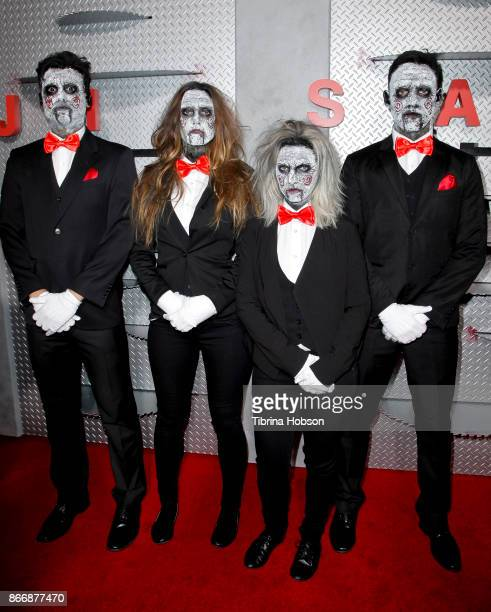 Actors dressed as Jigsaw attend the premiere of Lionsgate's 'Jigsaw' at ArcLight Hollywood on October 25 2017 in Hollywood California