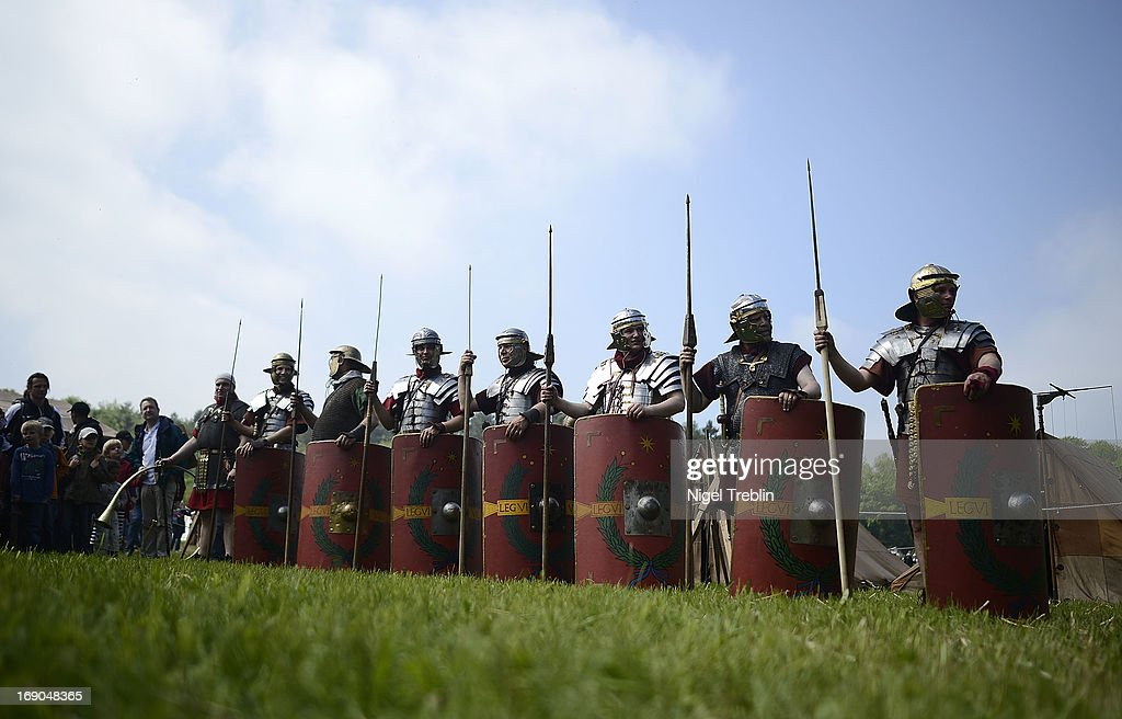 Actors dressed as Roman soldiers line up in their camp during a commemoration of the Battle of Teutoburg Forest (in German called the Varusschlacht) at the Kalkriese Museum and Park on May 19, 2013 in Bramsche-Kalkriese, Germany. Several hundred actors dressed as Roman and Germanic soldiers took part in the public event that included a cavalry display, hand to hand combat between gladiators and demonstrations of Roman artillery. The Battle of Teutobug Forest in 9 A.D. was a monumental defeat for the Romans in Germania, in which three legions led by Publius Quinctilius Varus were betrayed by Arminius, who was secretly aligned with Germanic tribes and led the legions into a trap in which up to 20,000 Roman soldiers were killed at the hands of Germanic warriors.