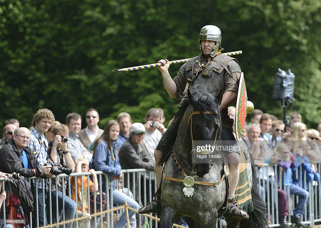 Actors dressed as Roman soldiers on horses shows fighting during a commemoration of the Battle of Teutoburg Forest (in German called the Varusschlacht) at the Kalkriese Museum and Park on May 19, 2013 in Bramsche-Kalkriese, Germany. Several hundred actors dressed as Roman and Germanic soldiers took part in the public event that included a cavalry display, hand to hand combat between gladiators and demonstrations of Roman artillery. The Battle of Teutobug Forest in 9 A.D. was a monumental defeat for the Romans in Germania, in which three legions led by Publius Quinctilius Varus were betrayed by Arminius, who was secretly aligned with Germanic tribes and led the legions into a trap in which up to 20,000 Roman soldiers were killed at the hands of Germanic warriors.