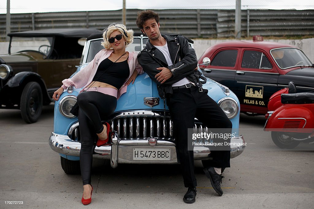 Actors dressed as 'Saturday Night Fever' film's characters pose for a picture with Buick Super Eight car from the 50s at the Jarama Circuit on June 9, 2013 in Madrid, Spain. The Jarama Vintage Festival seeks to revive the 1960s, 70s and 80s attracting classic cars and motorbikes against a background of public orientated activities and shows.