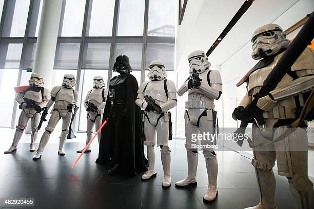 Actors dressed as Star Wars characters pose for the media during the opening ceremony for Lucasfilm Ltd's Sandcrawler building home to Lucasfilm's...