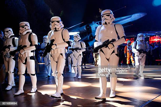 Actors dressed as Stormtrooper characters from 'Star Wars The Force Awakens' walk on Main Street during 'Star Wars Episode VII The Force Awakens'...