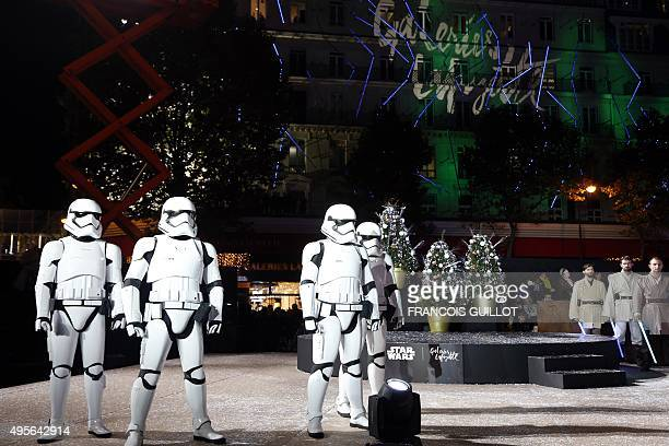 Actors dressed as stormtroopers from the Star Wars movie perform during the launch of the Christmas illuminations at the Galeries Lafayette shopping...