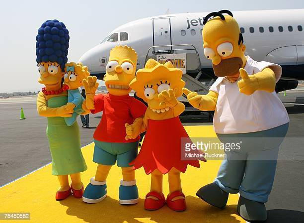 Actors dressed as the characters from the longrunning television cartoon series 'The Simpson' pose at the unveiling of Jet Blue's 'Simpson's' themed...
