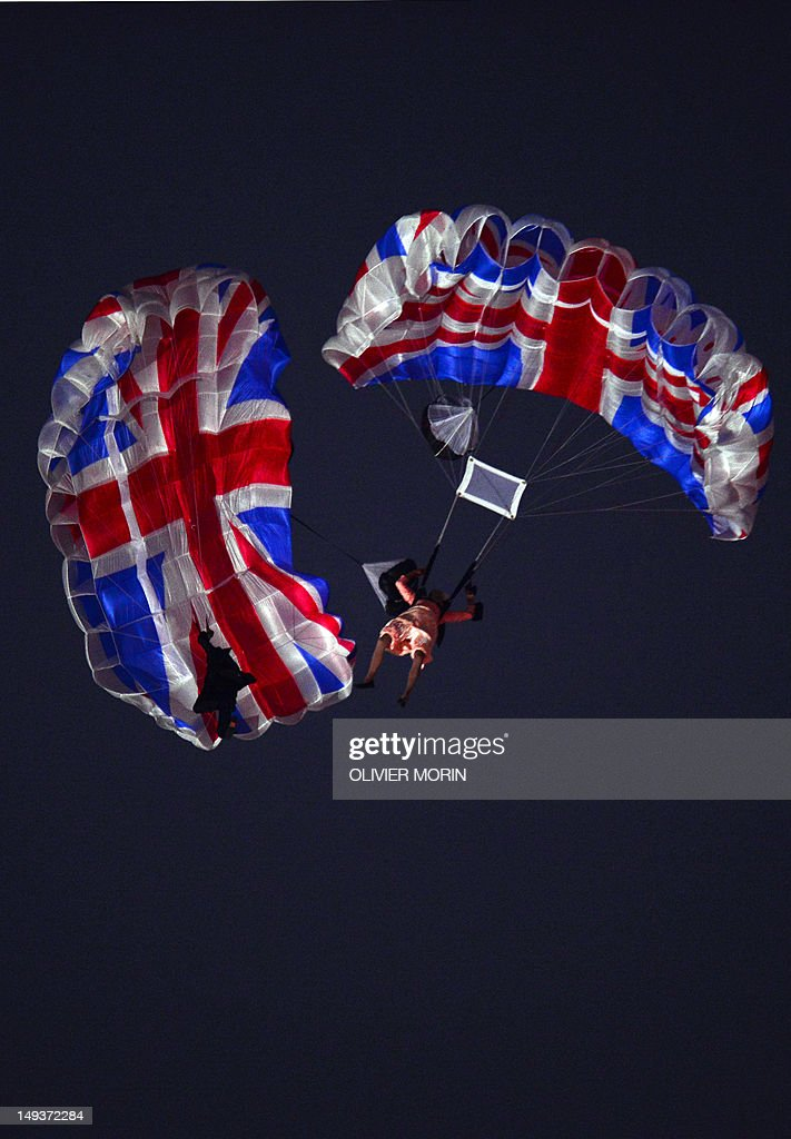 Actors dressed to resemble Britain's Queen Elizabeth II and James Bond parachute into the stadium during the opening ceremony of the London 2012 Olympic Games at the Olympic Stadium in London on July 27, 2012.
