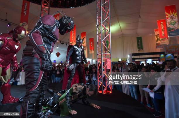 US actors dressed up as members of Marvel's Avengers perform on stage during Saudi Arabia's first ever ComicCon event in the coastal city of Jeddah...
