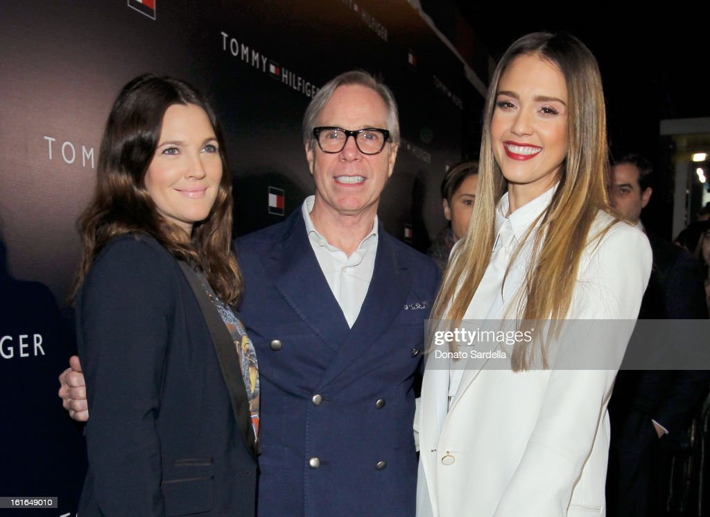 Actors Drew Barrymore and Jessica Alba and fashion designer Tommy Hilfiger attend Tommy Hilfiger New West Coast Flagship Opening on Robertson Boulevard on February 13, 2013 in West Hollywood, California.