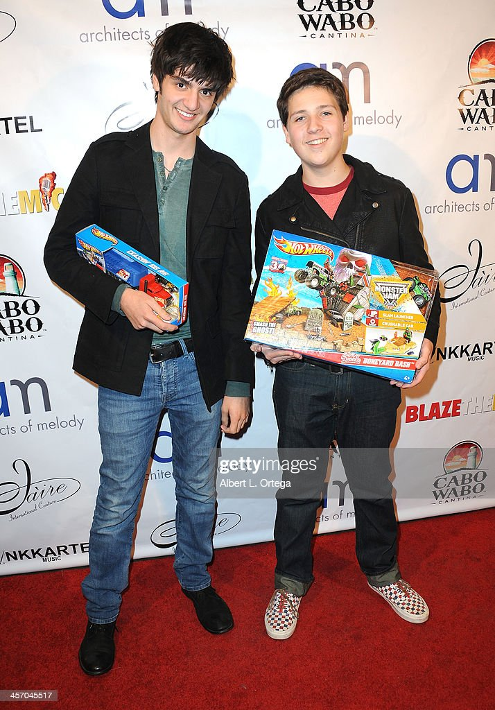 Actors Drew Leon and Zach Lewis attend Britticares Toy Drive with a benefit concert by G Tom Mac & Many Of Odd Nature in conjunction with publicist Michael Arnoldi's Birthday held at Cabo Wabo Cantina on December 15, 2013 in Hollywood, California.