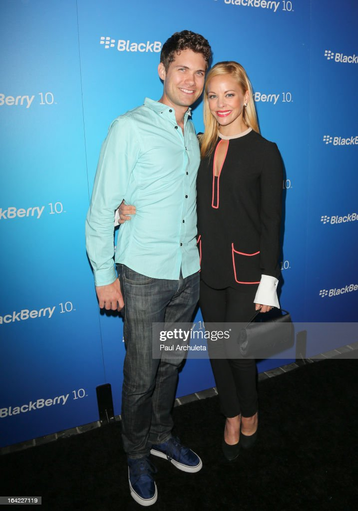 Actors Drew Seeley and Amy Paffrath (R) attend the BlackBerry Z10 Smartphone launch party at Cecconi's Restaurant on March 20, 2013 in Los Angeles, California.