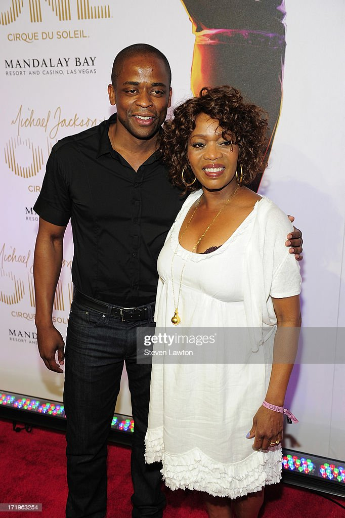 Actors <a gi-track='captionPersonalityLinkClicked' href=/galleries/search?phrase=Dule+Hill&family=editorial&specificpeople=213248 ng-click='$event.stopPropagation()'>Dule Hill</a> (L) and <a gi-track='captionPersonalityLinkClicked' href=/galleries/search?phrase=Alfre+Woodard&family=editorial&specificpeople=220969 ng-click='$event.stopPropagation()'>Alfre Woodard</a> arrive at the world premiere of 'Michael Jackson ONE by Cirque du Soleil' at THEhotel at Mandalay Bay on June 29, 2013 in Las Vegas, Nevada.