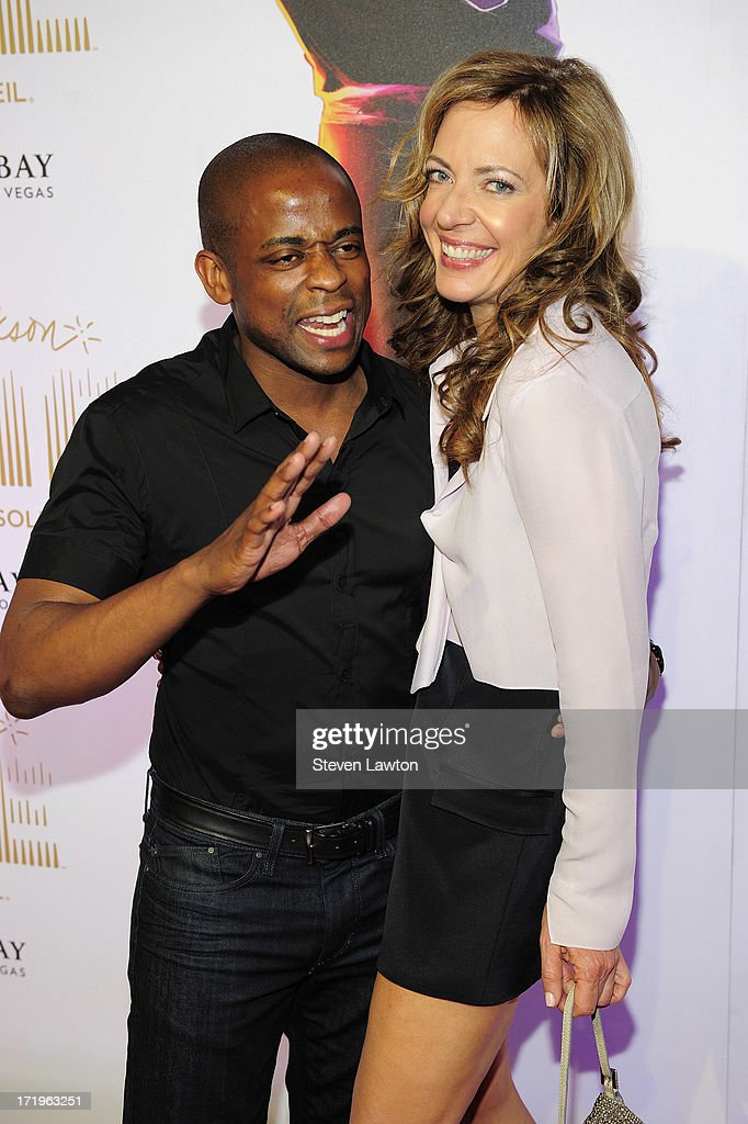 Actors <a gi-track='captionPersonalityLinkClicked' href=/galleries/search?phrase=Dule+Hill&family=editorial&specificpeople=213248 ng-click='$event.stopPropagation()'>Dule Hill</a> (L) and <a gi-track='captionPersonalityLinkClicked' href=/galleries/search?phrase=Allison+Janney&family=editorial&specificpeople=206290 ng-click='$event.stopPropagation()'>Allison Janney</a> arrive at the world premiere of 'Michael Jackson ONE by Cirque du Soleil' at THEhotel at Mandalay Bay on June 29, 2013 in Las Vegas, Nevada.