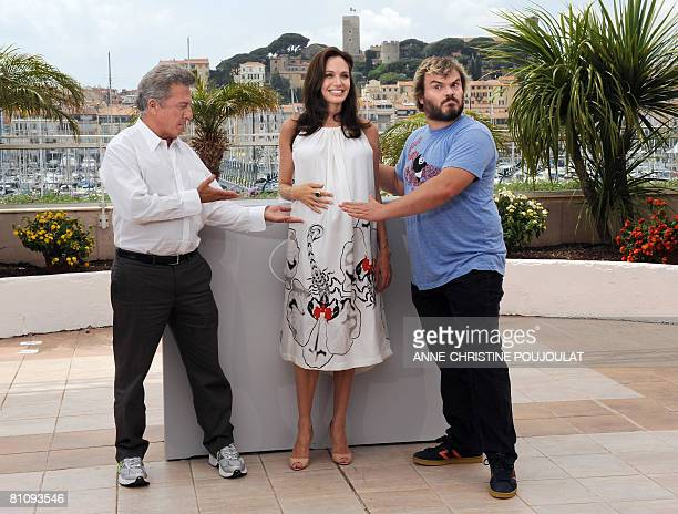 US actors Dustin Hoffman and Jack Black shows fellow actress Angelina Jolie's baby bump as they pose during a photocall for US directors John...
