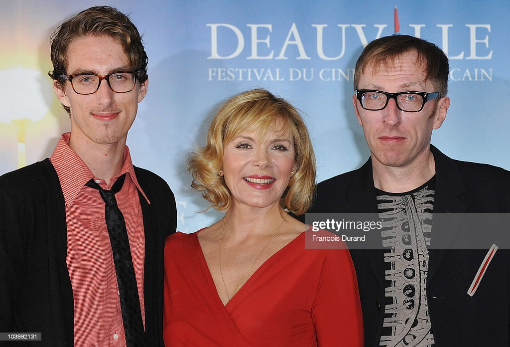 Actors Dustin Ingram, Kim Cattrall and director Keith Bearden attend the photocall for the film 'Meet Monica Velour' during the 36th Deauville American Film Festival on September 11, 2010 in Deauville, France.