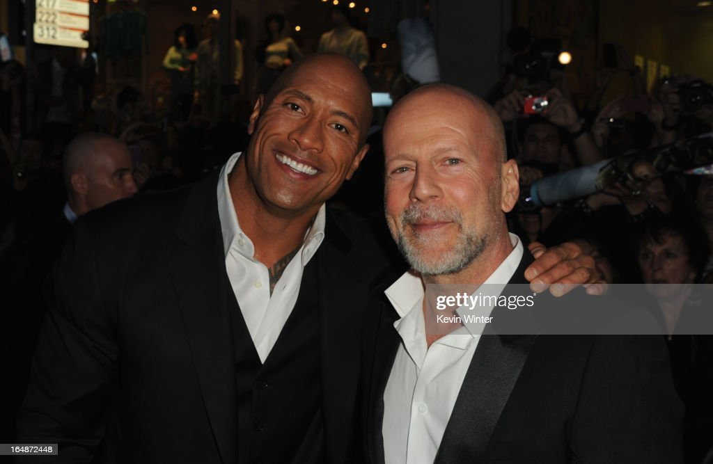 Actors <a gi-track='captionPersonalityLinkClicked' href=/galleries/search?phrase=Dwayne+Johnson&family=editorial&specificpeople=210704 ng-click='$event.stopPropagation()'>Dwayne Johnson</a> and <a gi-track='captionPersonalityLinkClicked' href=/galleries/search?phrase=Bruce+Willis&family=editorial&specificpeople=202185 ng-click='$event.stopPropagation()'>Bruce Willis</a> attend the premiere of Paramount Pictures' 'G.I. Joe:Retaliation' at TCL Chinese Theatre on March 28, 2013 in Hollywood, California.