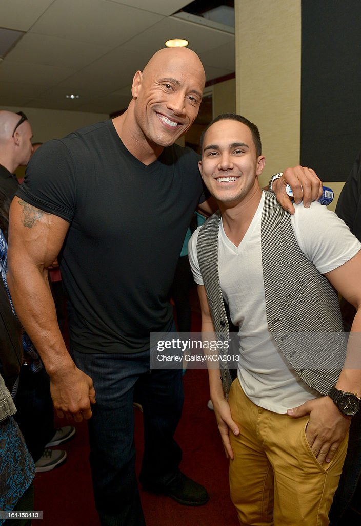 Actors Dwayne 'The Rock' Johnson and actor Carlos Pena pose backstage at Nickelodeon's 26th Annual Kids' Choice Awards at USC Galen Center on March 23, 2013 in Los Angeles, California.