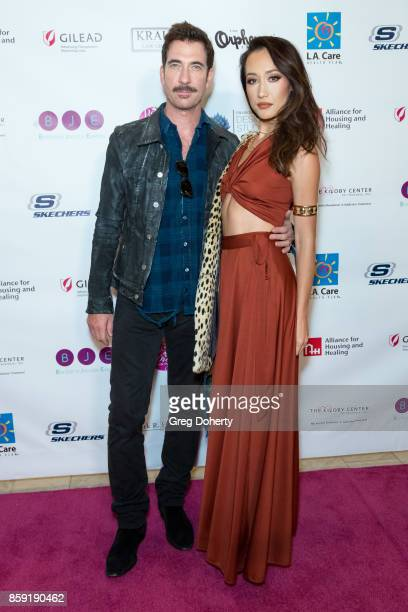 Actors Dylan McDermott and Maggie Q attend the Best In Drag Show 2017 at Orpheum Theatre on October 8 2017 in Los Angeles California