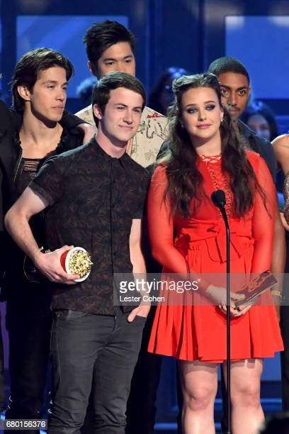 Actors Dylan Minnette and Katherine Langford speak onstage during the 2017 MTV Movie And TV Awards at The Shrine Auditorium on May 7 2017 in Los...