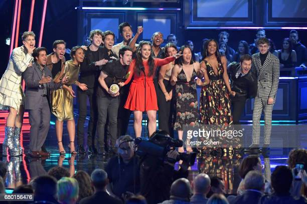Actors Dylan Minnette and Katherine Langford with fellow cast members from '13 Reasons Why' speak onstage during the 2017 MTV Movie And TV Awards at...