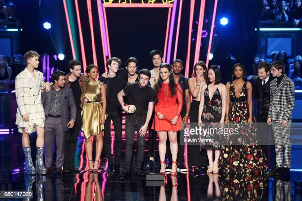 Actors Dylan Minnette and Katherine Langford with the cast of '13 Reasons Why' speak onstage during the 2017 MTV Movie And TV Awards at The Shrine...