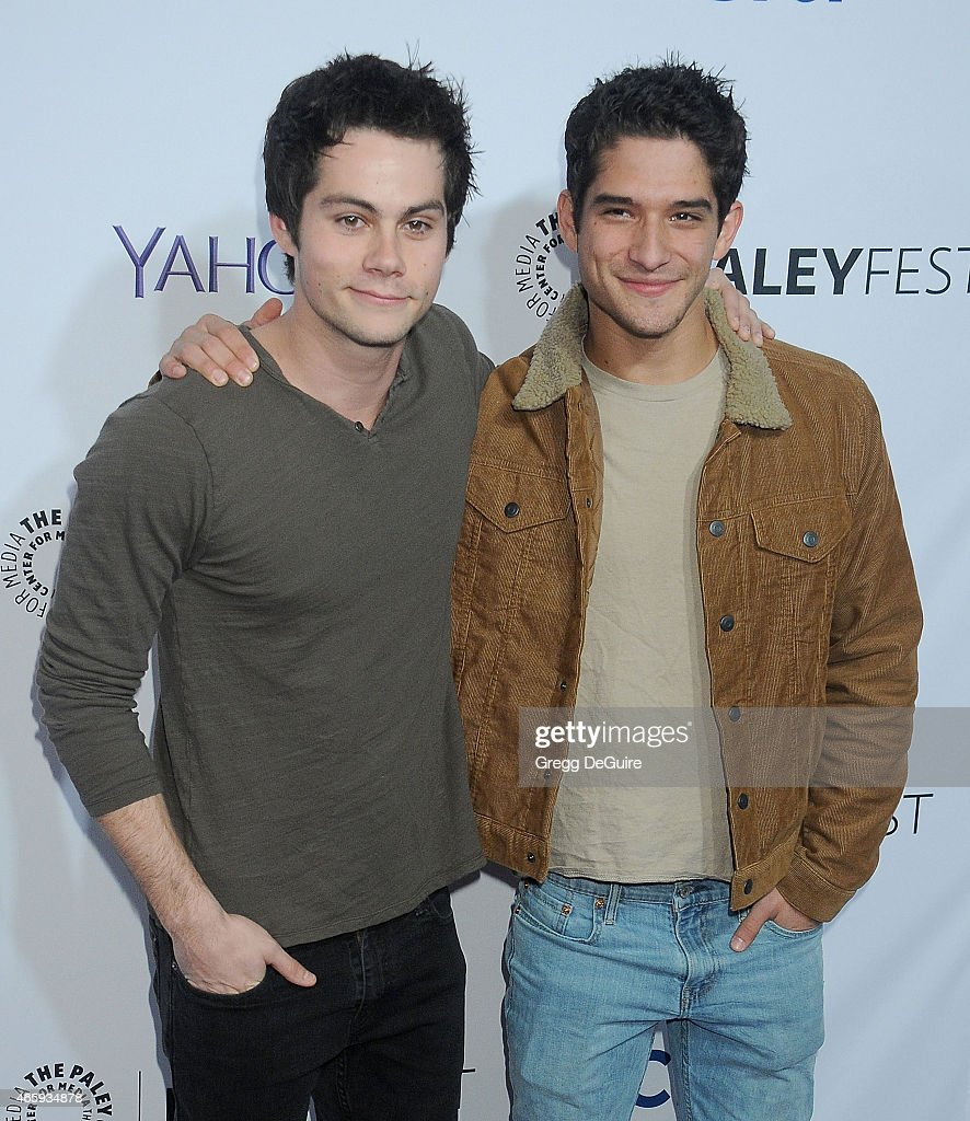 Actors Dylan O'Brien and Tyler Posey arrive at the 32nd Annual PALEYFEST LA 'Teen Wolf' at Dolby Theatre on March 11 2015 in Hollywood California