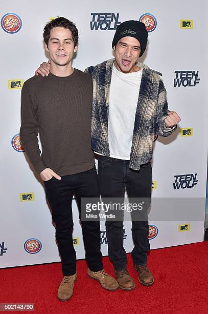 Actors Dylan O'Brien and Tyler Posey attend the MTV Teen Wolf Los Angeles premiere party at Dave Busters on December 20 2015 in Hollywood California