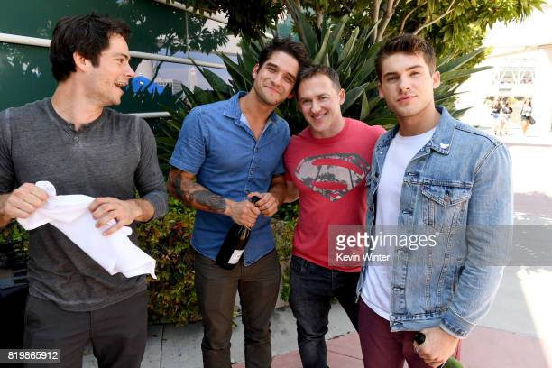 Actors Dylan O'Brien Tyler Posey executive producer Jeff Davis and actor Cody Christian from 'Teen Wolf' celebrate their final season backstage after...