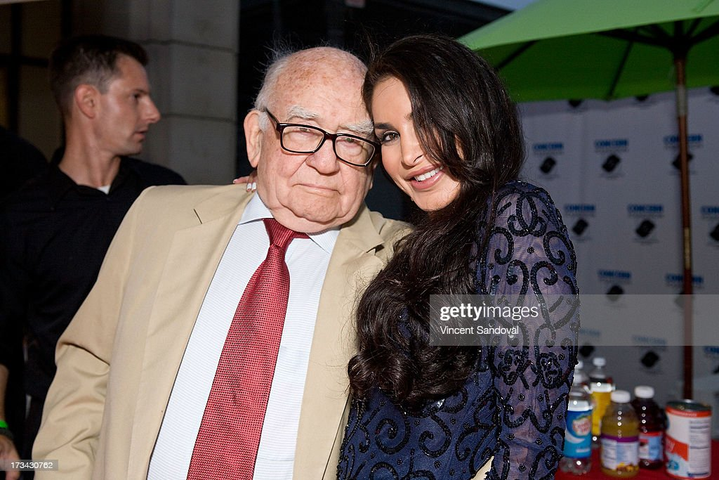 Actors <a gi-track='captionPersonalityLinkClicked' href=/galleries/search?phrase=Ed+Asner&family=editorial&specificpeople=216485 ng-click='$event.stopPropagation()'>Ed Asner</a> and <a gi-track='captionPersonalityLinkClicked' href=/galleries/search?phrase=Saye+Yabandeh&family=editorial&specificpeople=843255 ng-click='$event.stopPropagation()'>Saye Yabandeh</a> attend the Concern Foundation block party at Paramount Studios on July 13, 2013 in Hollywood, California.