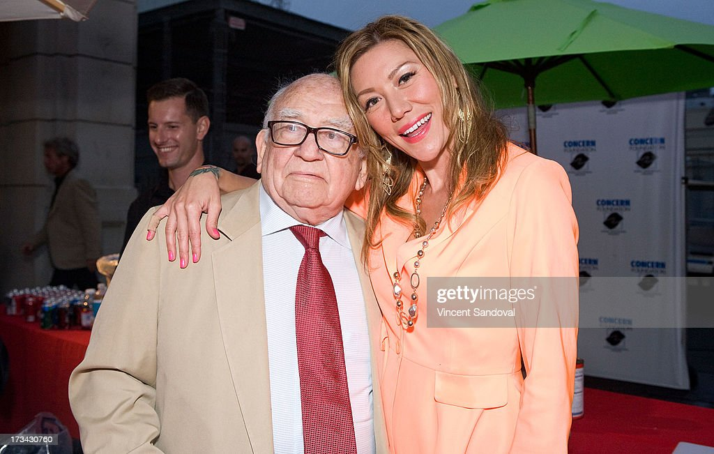 Actors <a gi-track='captionPersonalityLinkClicked' href=/galleries/search?phrase=Ed+Asner&family=editorial&specificpeople=216485 ng-click='$event.stopPropagation()'>Ed Asner</a> and Sun Nea attend the Concern Foundation block party at Paramount Studios on July 13, 2013 in Hollywood, California.