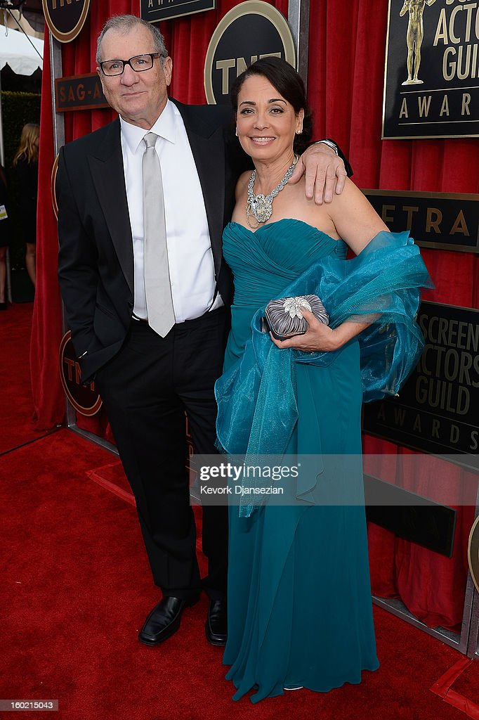 Actors Ed O'Neill and Catherine Rusoff arrive at the 19th Annual Screen Actors Guild Awards held at The Shrine Auditorium on January 27, 2013 in Los Angeles, California.
