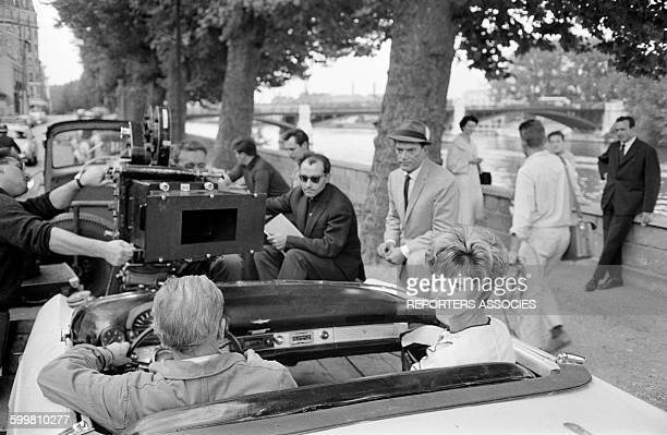 Actors Eddie Constantine and Valérie Boisgel on the Set of the Movie 'Alphaville' Directed by JeanLuc Godard in Paris France in 1965